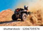 Quad Bike In Dust Cloud  Sand...