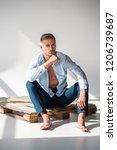 handsome adult man sitting on... | Shutterstock . vector #1206739687