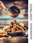 fried chicken wings with fries... | Shutterstock . vector #1206758251