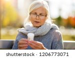 senior woman checking label on... | Shutterstock . vector #1206773071