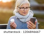 woman holding smartphone and... | Shutterstock . vector #1206846667