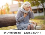 senior woman suffering from a... | Shutterstock . vector #1206856444