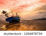 A Fishing Boat Stuck On The...
