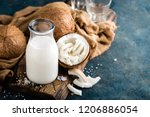 fresh coconut milk in glass... | Shutterstock . vector #1206886054