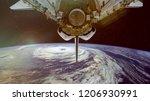 typhoon and spacecraft above... | Shutterstock . vector #1206930991