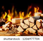 Stacked Dried Logs In Front Of...