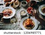 friends having a pasta dinner... | Shutterstock . vector #1206985771