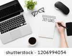 man is writing 2019 goals on... | Shutterstock . vector #1206994054