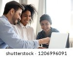 diverse happy interns learning... | Shutterstock . vector #1206996091