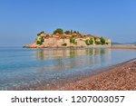 sveti stefan island and beach ...   Shutterstock . vector #1207003057