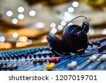 professional headphones on... | Shutterstock . vector #1207019701