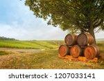 stack of wine barrels under a... | Shutterstock . vector #1207033141