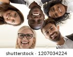 low angle shot of smiling... | Shutterstock . vector #1207034224