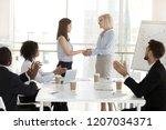 mature businesswoman handshake... | Shutterstock . vector #1207034371