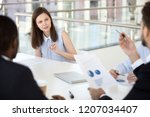 young female employee talk on... | Shutterstock . vector #1207034407