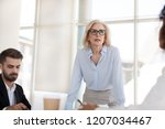 serious mature businesswoman... | Shutterstock . vector #1207034467