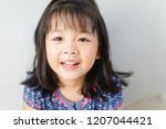 happy little asian girl child... | Shutterstock . vector #1207044421
