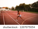 couple playing tennis at the... | Shutterstock . vector #1207075054