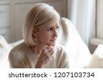 sad elderly woman looking in... | Shutterstock . vector #1207103734