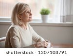 thoughtful senior woman... | Shutterstock . vector #1207103791