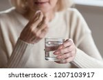 close up of aged female holding ... | Shutterstock . vector #1207103917