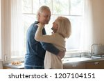 smiling aged couple in love... | Shutterstock . vector #1207104151