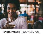 black woman drinking wine | Shutterstock . vector #1207119721