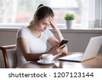 annoyed millennial woman... | Shutterstock . vector #1207123144