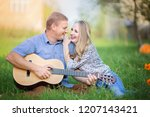 romantic couple outdoors | Shutterstock . vector #1207143421