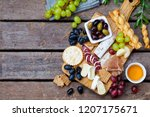 cheese and meat appetizers on... | Shutterstock . vector #1207175671