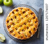 apple pie on a cooling rack.... | Shutterstock . vector #1207176037