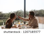 romantic couple eating... | Shutterstock . vector #1207185577