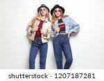 two playful friends having fun... | Shutterstock . vector #1207187281