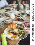 breakfast is in a cafe   Shutterstock . vector #1207201771