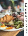 breakfast is in a cafe   Shutterstock . vector #1207201774