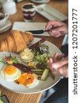 breakfast is in a cafe   Shutterstock . vector #1207201777