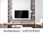 large smart tv mockup hanging...   Shutterstock . vector #1207219324