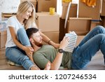 couple sitting on floor reading ... | Shutterstock . vector #1207246534