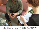 psychotherapist consulting man  ... | Shutterstock . vector #1207248367