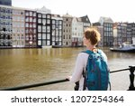 mature woman looking at the... | Shutterstock . vector #1207254364