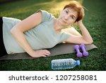 mature woman doing fitness...   Shutterstock . vector #1207258081