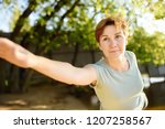 mature woman practicing yoga...   Shutterstock . vector #1207258567