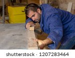 attractive man doing woodwork... | Shutterstock . vector #1207283464