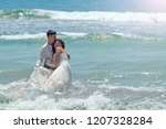 happy newlyweds hug and laugh... | Shutterstock . vector #1207328284