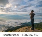 people take a picture on the... | Shutterstock . vector #1207357417