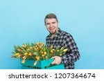 caucasian male gardener with... | Shutterstock . vector #1207364674