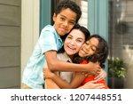 happy hispanic family   Shutterstock . vector #1207448551