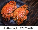 two cooked hairy crabs on the... | Shutterstock . vector #1207459891