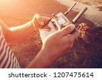 man holding remote controller... | Shutterstock . vector #1207475614