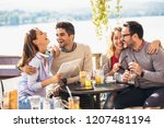 group of four friends having... | Shutterstock . vector #1207481194